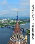 Small photo of Ottawa cityscape in the day over river with historical architecture.