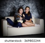 two young girls looks tv at... | Shutterstock . vector #369802244
