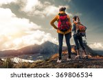 Two Ladies Hikers Standing On...