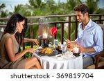 romantic couple having dinner... | Shutterstock . vector #369819704