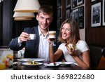 handsome couple having lunch | Shutterstock . vector #369822680