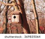 wooden birdhouse on a tree in... | Shutterstock . vector #369835064