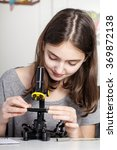 young student with microscope | Shutterstock . vector #369872138