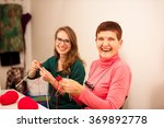 women knitting with red wool....   Shutterstock . vector #369892778