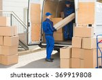 young male movers unloading... | Shutterstock . vector #369919808
