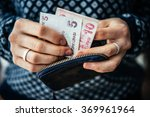 Hands Holding Turkish Lira...