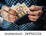 Hands Holding Euro Bills And...