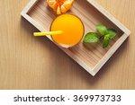 orange juice with mint in tray... | Shutterstock . vector #369973733