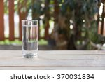 refreshing glass of water | Shutterstock . vector #370031834