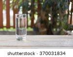 refreshing glass of water | Shutterstock . vector #370031834