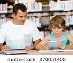 Small photo of Little boy and his father with laptop