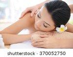 masseur doing massage on woman... | Shutterstock . vector #370052750
