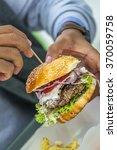 man holding american hamburger... | Shutterstock . vector #370059758