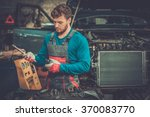 mechanic with pneumatic tool in ... | Shutterstock . vector #370083770