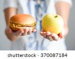choose between junk food versus ... | Shutterstock . vector #370087184