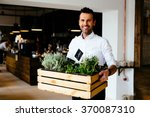 happy restaurant manager... | Shutterstock . vector #370087310