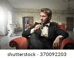 handsome man drinking wine | Shutterstock . vector #370092203