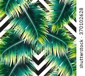 green palm leaves on the... | Shutterstock . vector #370102628