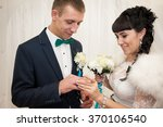 the newlyweds exchanged gold...   Shutterstock . vector #370106540