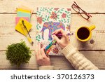 woman coloring an adult... | Shutterstock . vector #370126373