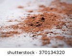 cocoa powder on a black stone... | Shutterstock . vector #370134320
