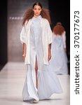 a model walks on the tako... | Shutterstock . vector #370177673