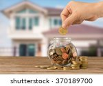 hand putting golden coins in... | Shutterstock . vector #370189700