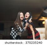 portrait of happy girls singing ... | Shutterstock . vector #370235240