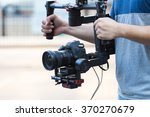 Videographer with gimbal video camera dslr, Professional video equipment, Videographer in event film production shoot video. - stock photo