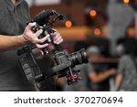 videographer using steady cam ... | Shutterstock . vector #370270694
