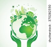 hands holding the green earth... | Shutterstock .eps vector #370282550