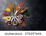 herbs and spices over black... | Shutterstock . vector #370297646
