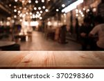 wood table  on blur bokeh cafe... | Shutterstock . vector #370298360