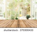 wooden board empty table in... | Shutterstock . vector #370300433