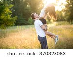 beautiful young loving couple... | Shutterstock . vector #370323083