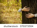 human hands hugging tree in the ... | Shutterstock . vector #370373504