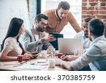 concentrated at work. group of... | Shutterstock . vector #370385759