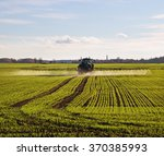 Tractor With Sprayer On A Wheat ...