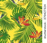 tropical flowers and leaves on... | Shutterstock .eps vector #370427324
