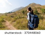 rear view of woman go hiking | Shutterstock . vector #370448060