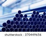Steel Tubes Against Industrial...