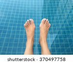 Feet In The Swimming Pool.