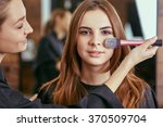 young  beautiful girl put on... | Shutterstock . vector #370509704