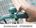 a girl ringing bell on bike. | Shutterstock . vector #370608830