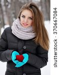 Woman Holding A Red Heart. The...