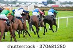 Stock photo race horses running towards the finish line 370681280