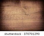 dark brown scratched wooden... | Shutterstock . vector #370701290