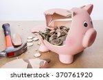 Broken Piggy Bank With Hammer...