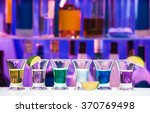 shot glasses with lime in row ... | Shutterstock . vector #370769498