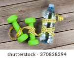 healthy food and fitness concept | Shutterstock . vector #370838294